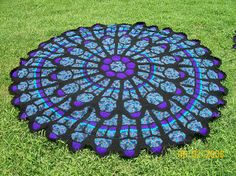 Cathedral Rose Window Afghan  This pattern is $7 on Ravelry.  It almost would be worth it.  Isn't that gorgeous?