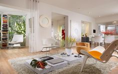 House in Miami by J Design Group The living room tables are amazing. They are so modern and very creative. The house is very bright which is something I really love.