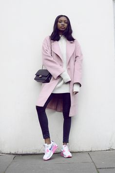 oversized pink coat + white cable-knit sweater + skinny jeans + pink Nike sneakers + black Chanel bag