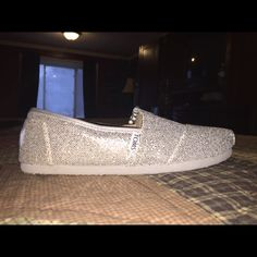 NWOT Toms Womens Classics Silver Glitter Retired style. Perfect for Weddings. NWOT Toms Womens Classics in Silver Glitter. Never worn or been out of the box except to try on initially and to take these photos. Have tags, but they are not attached to shoes. Includes box, original tag and dust bag. Size 7.5 TOMS Shoes Flats & Loafers