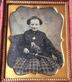 This is a daguerreotype of a smiling young girl holding a rod with her pet parrot on it. She is wearing a wonderful print skirt and a pocket watch around her neck. Daguerreotypes featuring animals are quite rare especially exotic animals like a parrot. | eBay!