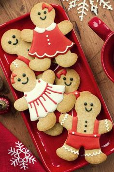Gingerbread men cookies and a little woman there too. Cute gingerbread woMEN and me with outfits.