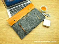 This one is probably the nicest one I've seen so far. Felt Macbook Air Case  Laptop Sleeve 13 inchMacbook 13 by TopFelt