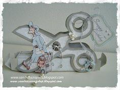 Sandra's Scrapshop Scissors over a box...how cute!