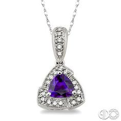 A large ocean blue trillion cut prong set Amethyst is haloed by 20 shimmering single cut diamonds, beautifully prong set and gorgeously dangles from a rope chain. #Amethyst #SwansonsDiamondCenter