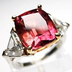 Natural Padparadscha Sapphire & Triangle Cut Diamond Ring ... i don't think i have ever seen anything quite like this