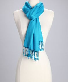 Wrap up with this versatile scarf that's soft and stylish. Twist or tie with any outfit as the perfect companion piece. The bold color and fringe hem act as classic complements.28'' x 76''55% viscose / 45% acrylicDry cleanImported