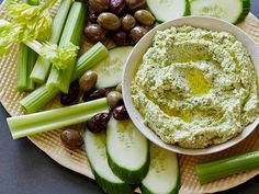 Get Edamame Hummus Recipe from Food Network Serve with sweet chili sauce, pepper jam, feta and shaved carrots.