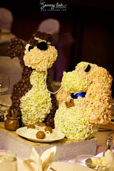 1 12 Floral Sculpture Centerpieces Each Table Using Different Famous Disney Character Also To Identify The