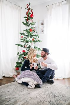 Happily Ever Allen. Chase Allen. Brit Allen. Couple goals. Fashion. Men's fashion. Women's fashion. Couples fashion. Street style. Casual style. Love. Inspiration. Cute couple. Blonde hair. Wavy hair. Makeup. Christmas. Christmas tree. Cozy Christmas. Holiday. Christmas pajamas.