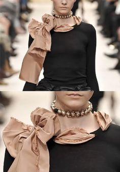 DIY couture shirt idea - take an old scarf or nice long piece of classy fabric, cut small holes along the collar of a plain tee, then string the fabric through. 1, 2, 3, high fashion!