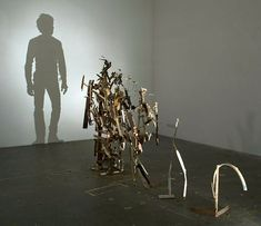 Junk sculptures by Tim Noble and Sue Webster that make incredible shadows - very cool.