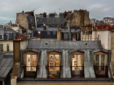 Permission to snoop: Gail Albert Halaban's gaze into Parisian apartments allows the mind to wander. Read the story via Slate.Learn more about Gail Albert Halaban: Paris Views on the Aperture book page. Art Parisien, Paris Neighborhoods, Paris Rooftops, Grande Hotel, My Little Paris, Paris Apartments, Parisian Apartment, Through The Window, The Neighbourhood