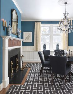 Love the blue walls with the white woodwork.  Very crisp and fresh.  House of Turquoise: Taylor Interior Design