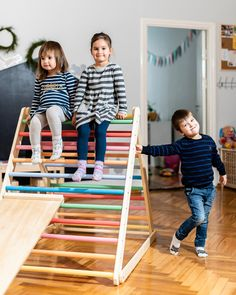Indoor play equipment for kids may sell out this winter if were all stuck in doors. Love this Pikler triangle from Etsy seller Home for Dreams - grab one now while you can!  | quarantine | covid | play room | parenting tips | family tips | kids furniture | Montessori furniture | handmade kids furniture