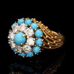 CARTIER, Paris.circa 1955.Diamond, turquoise & yellow gold cluster ring