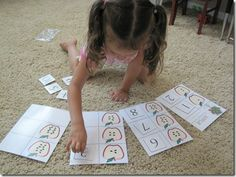 COUNTING | We use fun counting cards to practice counting and number recognition at the same time. Here she is counting apple seeds then putting the correct number card next to the apple based on the amount of seeds on it.