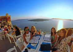 Take your lunch with the most beautiful view! #Santorini #Gastronomy Photo on kiwiflies