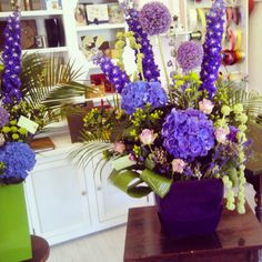 Purple flowers designs for a corporate event by Atelier Floristic Aleksandra concept Alexandra Crisan