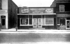 Taken in the the early 1830's this photo shows the business block on the corner of Cummington Square West and Bridgewater Street.  Once the home of Evan's Drug Store and Roy Muma's Barber Shop, it is now the home of Chippawa Movieland. Niagara Falls Public Library. Canada 150.