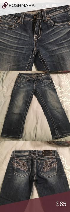 Size 28 Miss Me jean capris Size 28 Miss Me Jean capris with rhinestone wings on back pocket Miss Me Jeans Skinny