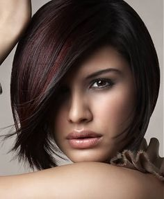 A modern bob - long in front, shorter in back. Great color!