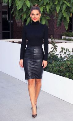 How to update your work and office style: Switch the standard pencil skirt for a leather option and pair with a black top for a monochromatic outfit. Add a top know and red lip for a polished finish.