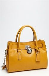I want to own a bag by Michael Kors. I love this yellow one.