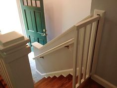 Our great idea for the week. Client, Janet Forde, made this child gate. It is totally retractable into her hall closet so that she doesn't loose space with it swinging in or out. This is a raised ranch with a closet just to the right of the stairway. I think you can see how it would close neatly into the closet.