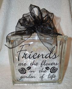 This is a beautiful Glass Block 8x8x3 featuring Friends are the flowers in the garden of life in vinyl with shinny paper filling and accented with black mesh ribbon. The price shown is for the block a