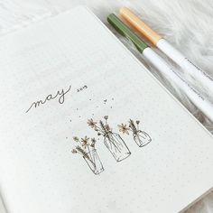 If you're looking for cover page inspirations or May theme ideas for your upcoming bullet journal setup, keep on reading. Bullet Journal Cover Page, Bullet Journal Aesthetic, Bullet Journal Notebook, Bullet Journal Junkies, Bullet Journal Ideas Pages, Bullet Journal Spread, Bullet Journal Layout, Bullet Journal Inspiration, Journal Pages