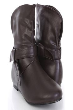 Make a fashion statement with these sexy ankle boots! They will look super hot paired with your favorite skinnies or dress. Make sure you add these to your closet, it definitely is a must have!The features include knotted strap detailed, low heel, stitched detail, smooth lining, and cushion foot bed. Approximately 1/2 inch heel, 12 inch circumference,7 inch shaft.