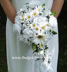 $332 Daisy Wedding Flower Package: includes Bridal bouquet, throw bouquet, maid of honor bouquet, 5 bridesmaid bouquets, 1 groom boutonniere, 1 best man boutonniere, 5 Honor Family Women Corsages, matching table centerpiece for the table, and shipping!    (getting boutonnieres elsewhere because these ones are roses, not daisies...)