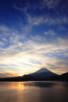 Mt. Fuji stands majestic against a tie-dye sky.