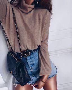 Mock neck + denim mini skirt.