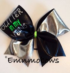 Glitter in My Veins Tick Tock Cheer Bow on Etsy, $12.50