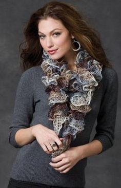 The Smoky Swirls Sashay Scarf is an excellent gift idea for Christmas. This free knit scarf pattern doesn't take long to whip up, and the results are absolutely fantastic. Use Red Heart Sashay Yarn in Waltz to create an accessory in neutral colors. Knit Or Crochet, Crochet Scarves, Crochet Shawl, Free Crochet, Crochet Ruffle, Crochet Granny, Crochet Blankets, Crochet Doilies, Ruffle Yarn