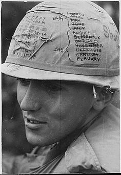 """I'll be home soon: A sky trooper from the 1st Cavalry Division keeps track of the time he has left on his """"short time"""" helmet, 1968."""