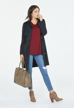 A trench coat has been a wardrobe staple for decades, and this stylish and functional one is perfect for fall. It features a long hemline and cinched waist....