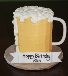 """Beer Mug Cake - My husband requested a beer mug cake for his birthday.  All buttercream, with fondant handle and """"banner""""."""