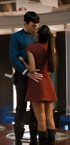Spock and Uhura - Star Trek I want a love like spock loves Uhura it's COMPLETELY LOGICAL!!!! diferent races different cultures AND they balance between their perfect precious love story. side not Cause of death Spock's hand on Uhura's waist and her hand OVEER HIS HEART!!!!!!!!