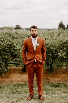 Groom outdoor portrait with an orange/brown suit from a modern rustic wedding at The Butler Barn Wedding by Dawn Charles, Oregon based Photographer inspiration Brown Suit Wedding, Orange Wedding, Wedding Men, Wedding Suits, Wedding Attire, Wedding Rustic, Orange Suit, Brown Suits, Navy Suits