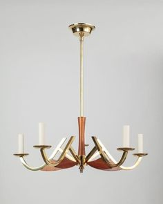 Teak and brass chandelier circa 1960.  Wood grounds the arcing brass with stunning geometry.
