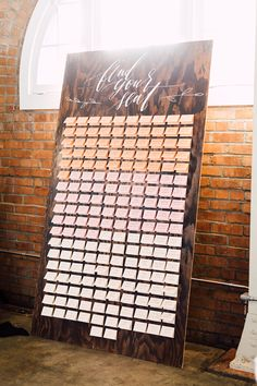 ombré wedding seating chart - photo by Plum and Oak Photo http://ruffledblog.com/a-must-see-industrial-wedding-with-gorgeous-florals