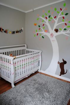 @Lizz Bridges-cute striped fabric in the crib, and there's even a tree! Plus, your parents would love the dachshund :)