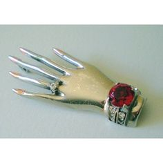 Vintage Sterling Brooch of a Hand Wearing Jewelry.