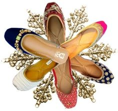 Leather juttis with patent finish for office wear, floral prints for casual wear, funky prints, crystal embedded juttis, pearl encrusted juttis