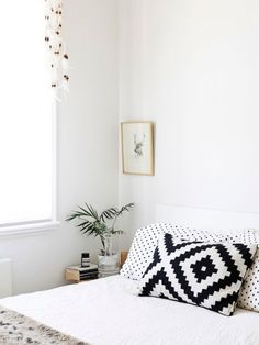 simple bedroom - black and white pillows