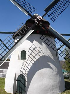 Mostert's Mill in Mowbray, Cape Town, South Africa. Built in it is the only working mill in Africa south of the Sahara. Its thatched roof is actually a revolving cap that allows the sails to be turned into the wind. Clifton Beach, Old Windmills, Virgin Atlantic, Cape Town South Africa, Most Beautiful Cities, Le Moulin, Africa Travel, Live, Places To See