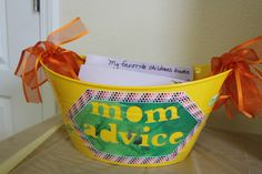 Bucket with cards so people can write down their advice for the mom to be.